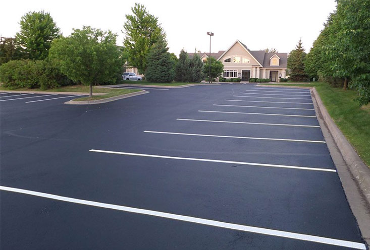 Parking Lot After Patching, Sealing, and Striping (commercial parking lot asphalt sealcoating repair)