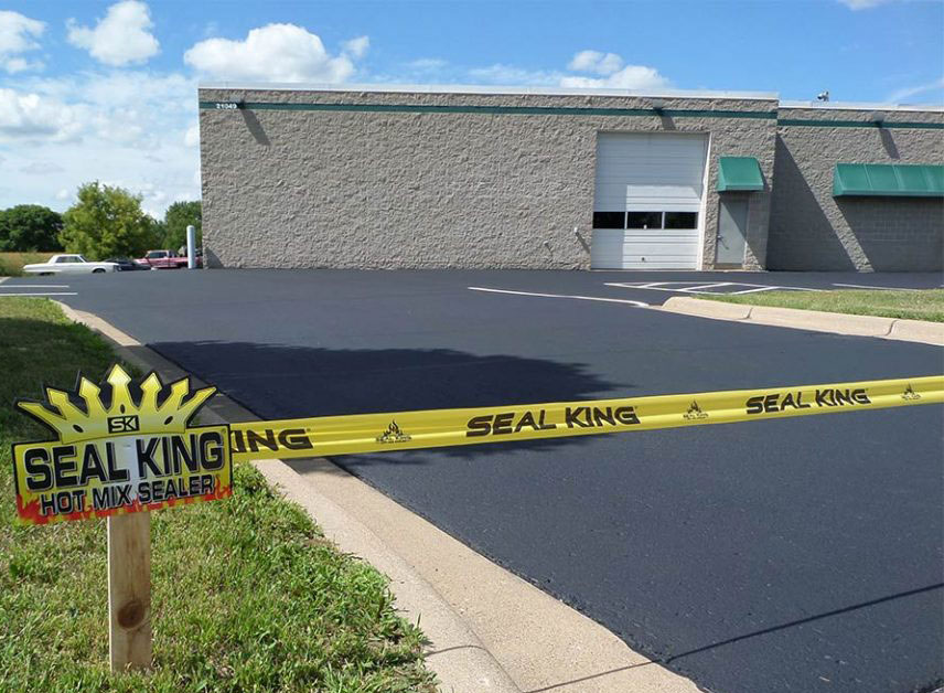Our Hot Mix Sealer Used on Commercial Parking Lot - Finished, after striping.
