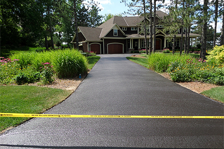 Finished asphalt driveway after seal coating