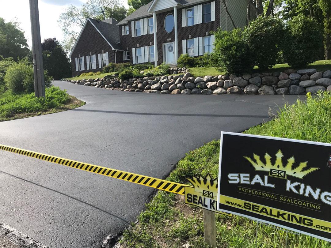 Finished asphalt driveway after sealcoating